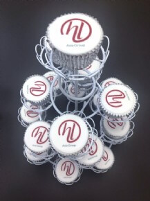 A tower of logo cupcakes to celebrate the launch of a new group