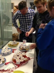 Some of the 200 employees admiring the selection of cupcakes