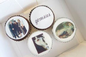 Cupcakes with a company logo and photo's