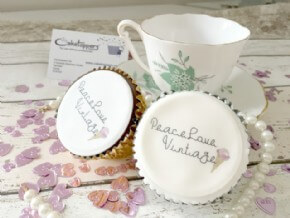 Dainty and delicious display of logo cupcakes for Peace Love Vintage