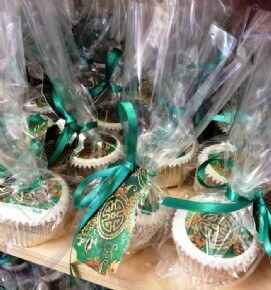Skandia 'Wrapped in Silk' Logo Cupcakes in bags and tied with a ribbon