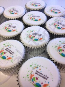 Welcome to Our World of Digital logo cupcakes
