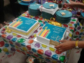 Furniture Village celebrating their birthday with logo cakes