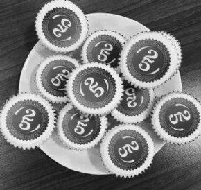 Irwin Mitchell celebrating 25 years with logo cupcakes