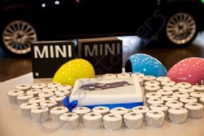 Corporate logo cupcakes and a photo cake for one of Mini's events
