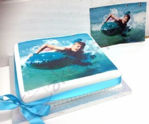 A customer's photo cake with the original photograph
